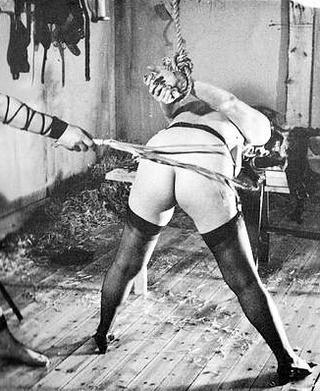 vintage rope bondage whipping scene