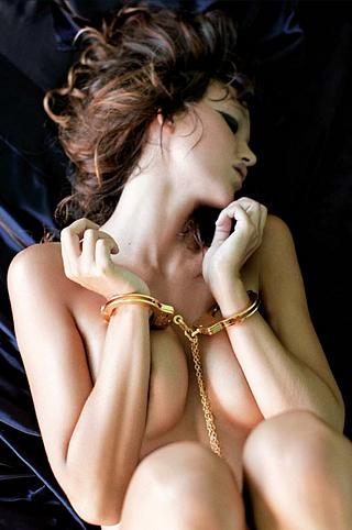 handcuffed with gold cuffs
