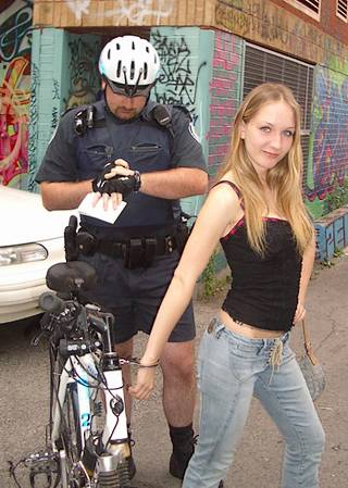 handcuff bondage for woman arrested by a bicycle cop
