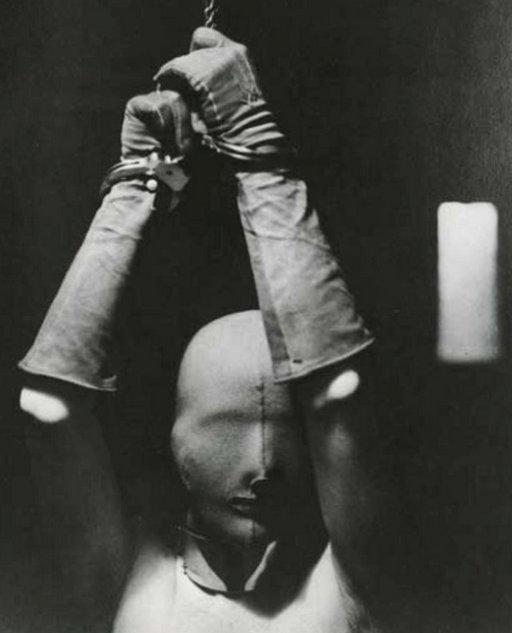 handcuffed woman in fabric hood