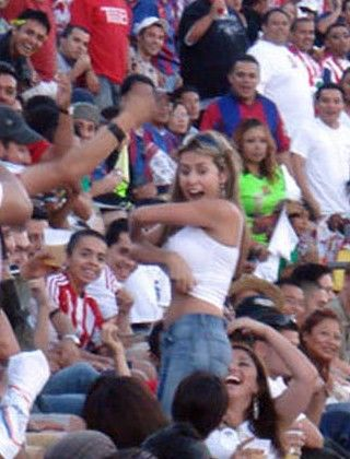 soccer hooligan girl shows her titties to the crowd