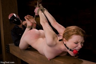 Madison Young hogtied and gagged with red rubber ball gag