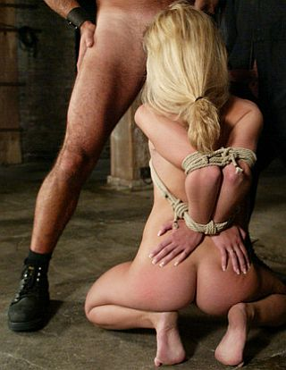 kneeling slavegirl in bj position