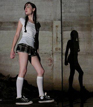 schoolgirl exploring scarey basement