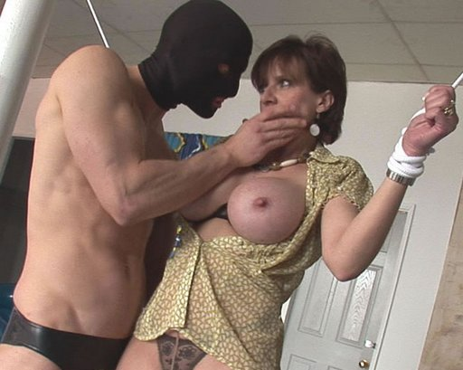 masked intruder plays with Lady Sonia