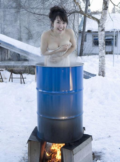 girl bathing in a barrel over a fire on a cold snowy day. Or, somebody is making girl soup. Take your pick.
