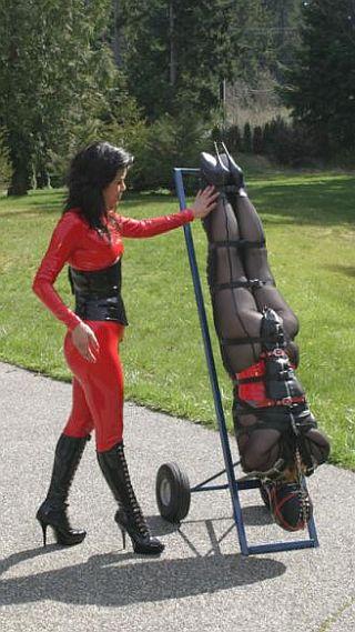 bondage girl on a handcart