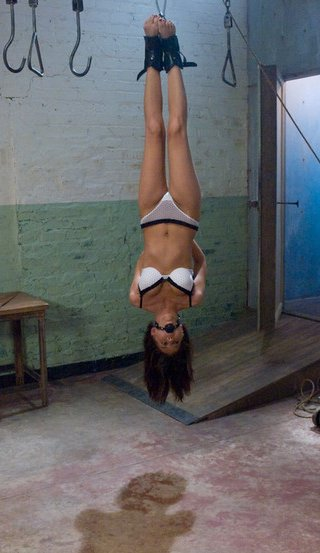 girl hung up like meat