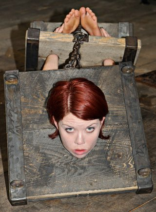 lila in heavy wooden punishment stocks