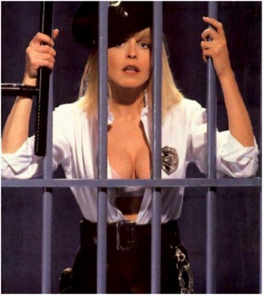 pretty jailer behind bars