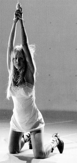 Jessica Alba kneeling prettily in bondage