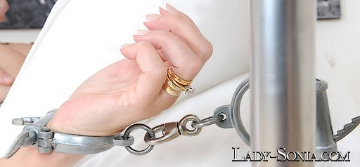 dominatrix lady sonia shackled to her own bed with her own cuffs