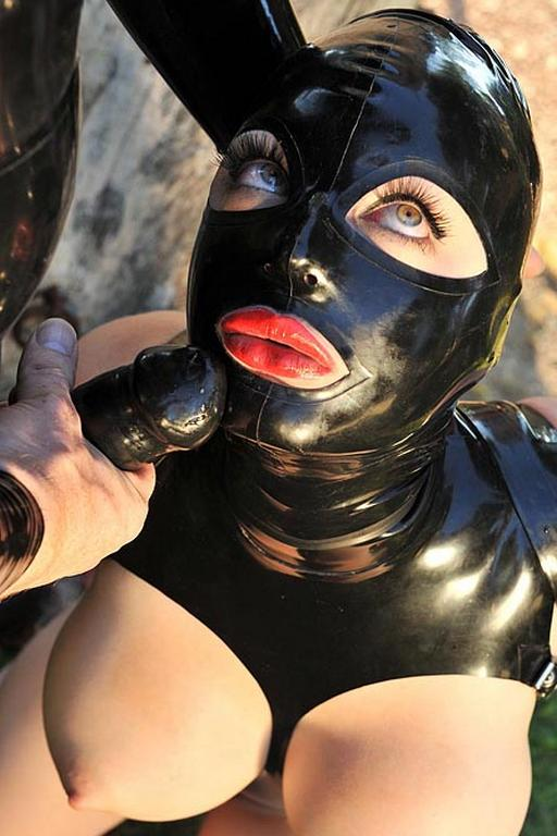 latex fetish model about to suck a rubber dick
