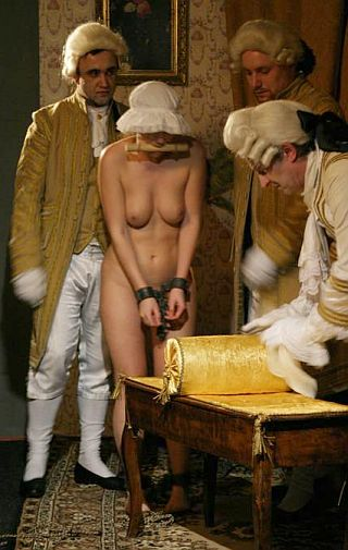 shackled serving wench prepared for punishment