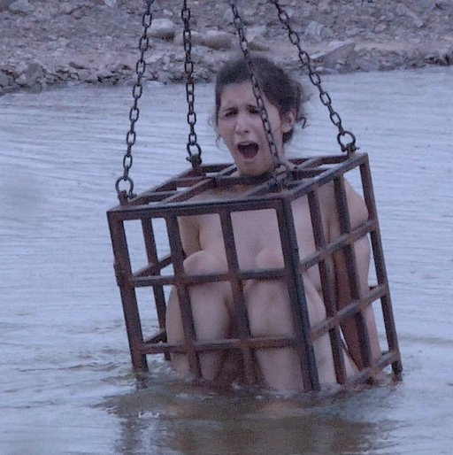 marina shrieks as the cold water rises around her naked helpless body