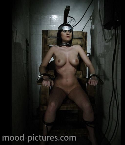 bondage electric chair for inflicting pain on nude prisoner women