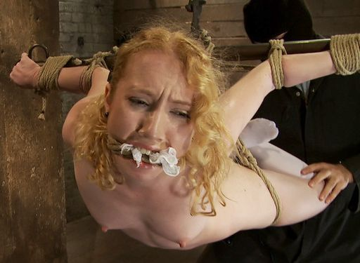 nikki blue gagged and suspended in rope bondage