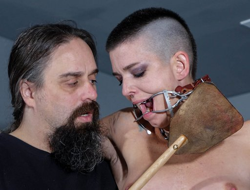 Alebeard menaces Abigail Dupree with a face-slapping leather spanking toy