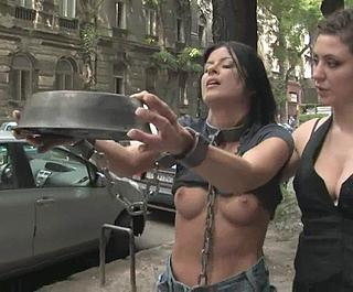 public bondage -- chained puppygirl with feeding bowl on streets of san francisco
