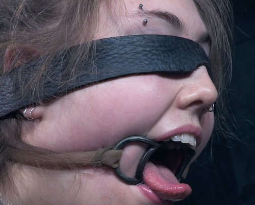 electra rayne shows off her purdy mouth and tries to lick a dick with her pert tongue through a confining ring gag