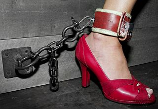 red shoe and a bondage ankle cuff