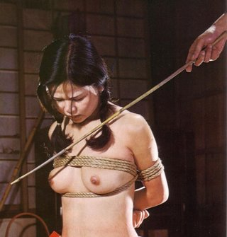 asian woman tied and about to be caned