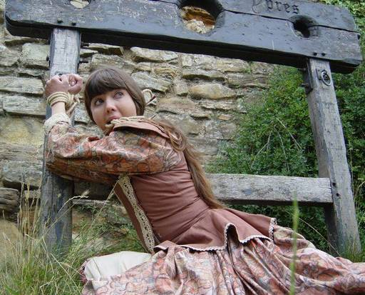 Rosaleen Young tied to a pillory