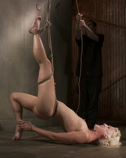Tall blonde Dylan Ryan in severe suspension bondage at Sadistic Rope
