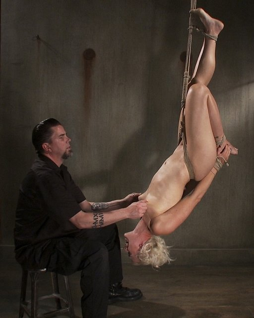 Tall blonde Dylan Ryan in harsh suspension bondage at Sadistic Rope