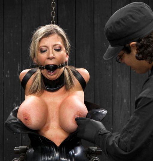 big breasted sara jay in a rubber corset and pipe bondage