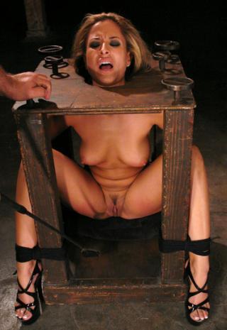 wooden bondage cart for enforced blowjobs