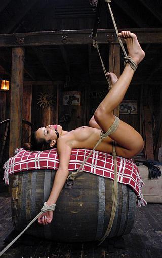 over a barrel for bondage fucking