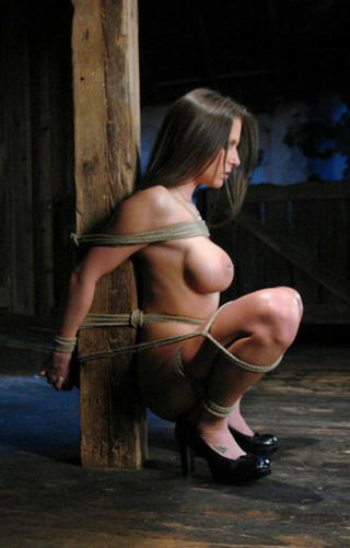 rachel roxxx tied to a post in a squat