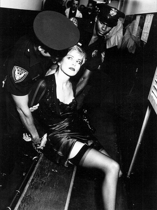 sharon stone shackled to a police station bench