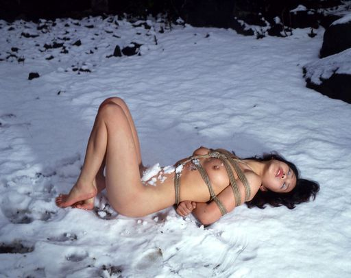 cold girl in rope bondage in the snow
