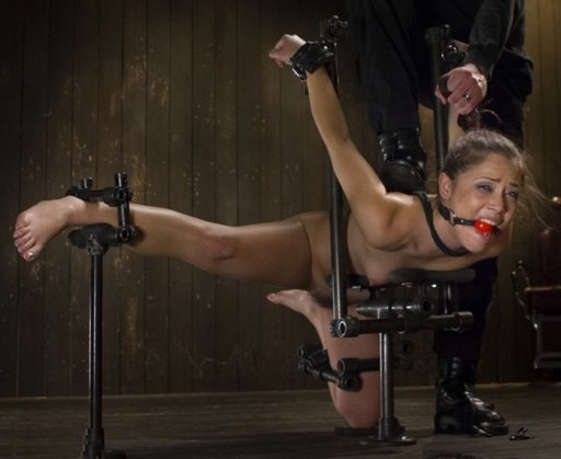Kristina Rose suffering in steel bondage