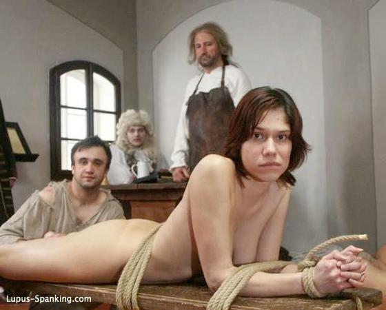 whipped girl tied to a spanking bench