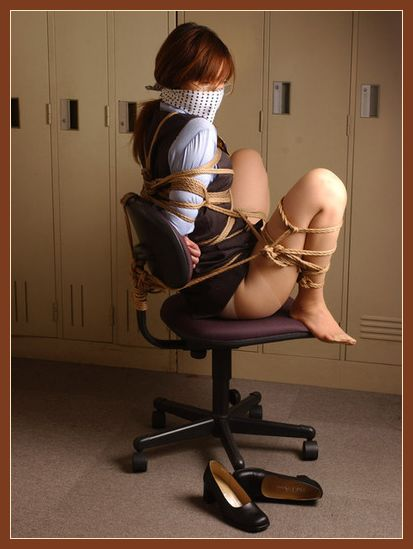 japanese bondage girl tied to an office chair
