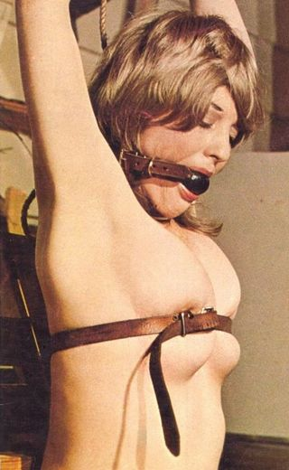 leather belt around breasts of bound woman