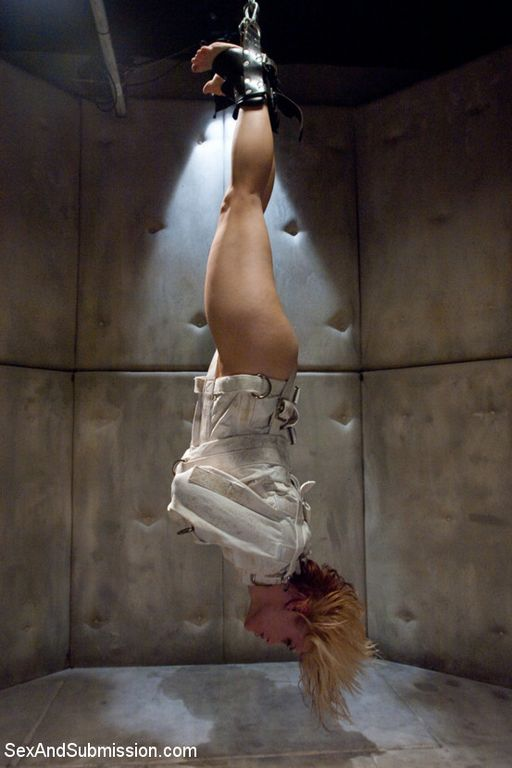 straitjacketed girl suspended in a padded cell - dangerous!