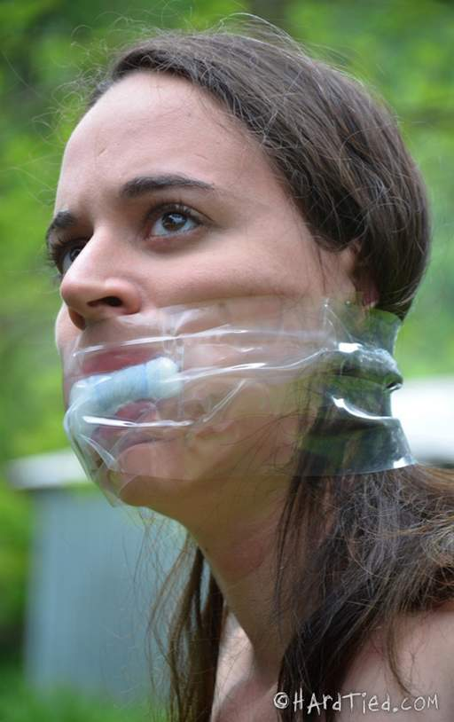 taped cloth in mouth gag