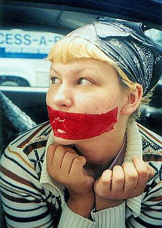 celebrity protester has mouth taped shut in public