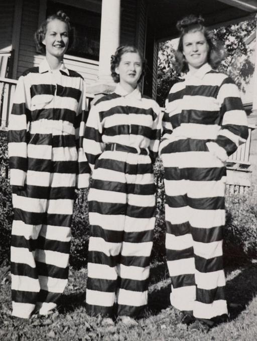 three women in black-and-white striped chain gang convict prisoner outfits