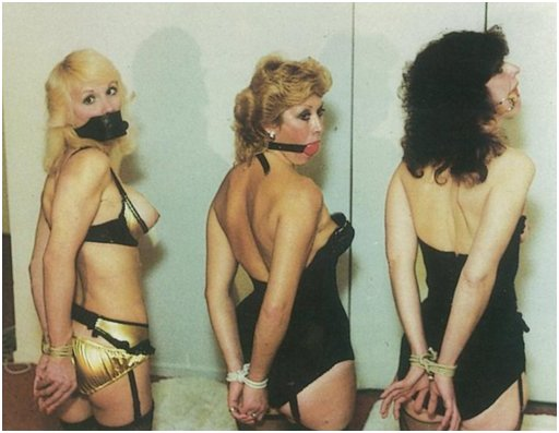 three gagged women with tied wrists