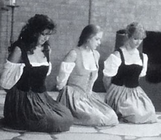 three women kneeling in submission