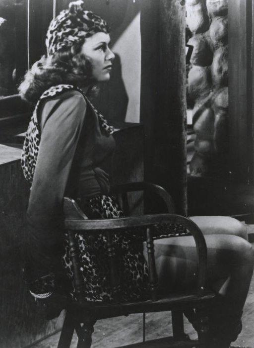 chair bondage for tiger woman wearing leopard spot print skin costume