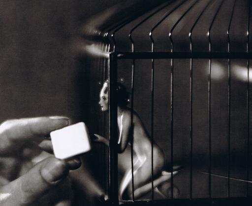 tiny woman in a bird cage