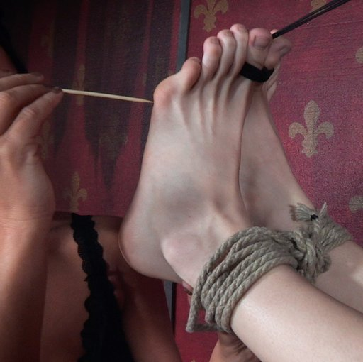 tickling and pricking her sensitive soles of her feet