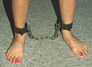 pretty feet in steel bondage