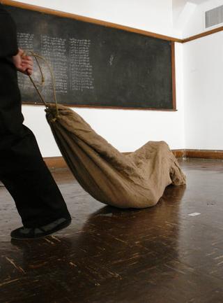 slave girl in a gunnysack
